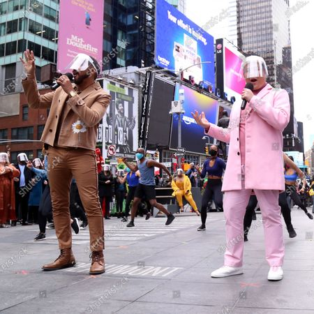 Stock Image of Charl Brown and Kelvin Moon Loh participating in We Will Be Back, presented by Broadway Cares/Equity Fights AIDS, NYCNext, and the Times Square Alliance, held in Duffy Square, on March 12, 2021, in New York City.