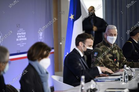 "French President Emmanuel Macron and French Armies Chief of Staff General Francois Lecointre during a meeting on defense space strategy at the French National Space Agency (CNES) as France hosts the first space situational awareness experiment in Europe, codenamed ""AsterX 2021"", in Toulouse, southern France on March 12, 2021."