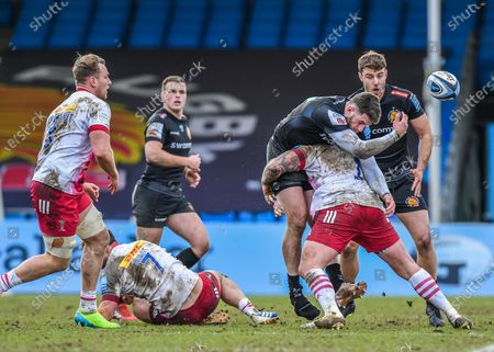 Stock Picture of Alex Cuthbert of Exeter Chiefs is tackled by Joe Marler of Harlequins  during the Gallagher Premiership Rugby match between Exeter Chiefs and Harlequins at Sandy Park, Exeter