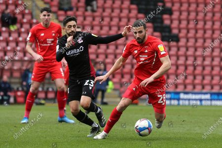 Nick Freeman of Leyton Orient and Jem Karacan of Scunthorpe United during Leyton Orient vs Scunthorpe United, Sky Bet EFL League 2 Football at The Breyer Group Stadium on 13th March 2021