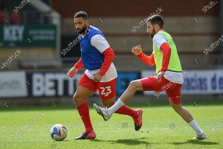 Leyton Orient's Jamie Turlev (23) and Nick Freeman warming up during the EFL Sky Bet League 2 match between Leyton Orient and Scunthorpe United at the Breyer Group Stadium, London