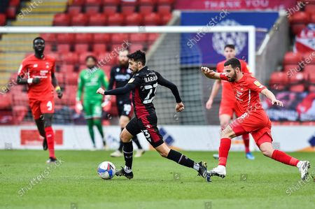 Jem Karacan (23) of Scunthorpe United gets away from Leyton orient Nick Freeman (28) during the EFL Sky Bet League 2 match between Leyton Orient and Scunthorpe United at the Breyer Group Stadium, London