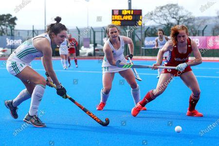 Ireland vs Great Britain. Ireland's Hannah McLoughlin and Lizzie Colvin with Sarah Jones of Great Britain