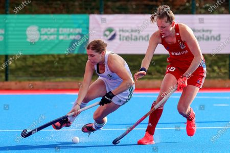 Stock Image of Ireland vs Great Britain. Ireland's Katie Mullan and Giselle Ansley of Great Britain