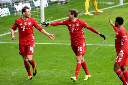 Bayern's Leon Goretzka, left, celebrates with Thomas Mueller and Serge Gnabry, right, after scoring the opening goal during the German Bundesliga soccer match between Werder Bremen and Bayern Munich in Bremen, Germany