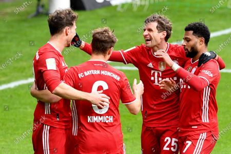 Bayern's Leon Goretzka, left, celebrates with Joshua Kimmich, Thomas Mueller and Serge Gnabry, right, after scoring the opening goal during the German Bundesliga soccer match between Werder Bremen and Bayern Munich in Bremen, Germany