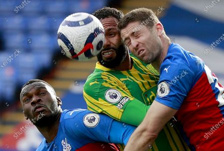 Christian Benteke (L) and Gary Cahill (R) of Crystal Palace in action against Kyle Bartley (C) of West Bromwich during the English Premier League soccer match between Crystal Palace and West Bromwich Albion in London, Britain, 13 March 2021.