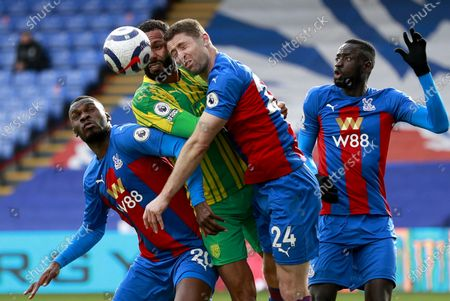 Christian Benteke (L) and Gary Cahill (2-R) of Crystal Palace in action against Kyle Bartley (2-L) of West Bromwich during the English Premier League soccer match between Crystal Palace and West Bromwich Albion in London, Britain, 13 March 2021.
