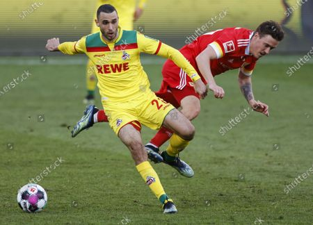 Cologne's Ellyes Skhiri (L) in action against Union's Max Kruse (R) during the German Bundesliga soccer match between FC Union Berlin and FC Koeln in Berlin, Germany, 13 March 2021.