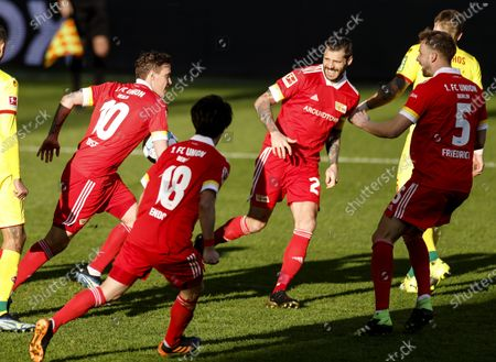 Union's Max Kruse (L) celebrates with teammates after scoring the 1-1 equalizer from the penalty spot during the German Bundesliga soccer match between FC Union Berlin and FC Koeln in Berlin, Germany, 13 March 2021.