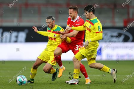 Stock Image of Marcus Ingvartsen (C) of Union in action against Cologne players Ellyes Skhiri (L) and Jorge Mere (R) during the German Bundesliga soccer match between FC Union Berlin and FC Koeln in Berlin, Germany, 13 March 2021.