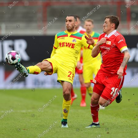 Max Kruse (R) of Union in action against Ellyes Skhiri (L) of Cologne during the German Bundesliga soccer match between FC Union Berlin and FC Koeln in Berlin, Germany, 13 March 2021.