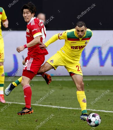 Union's Keita Endo (L) in action against Cologne's Ellyes Skhiri (R) during the German Bundesliga soccer match between FC Union Berlin and FC Koeln in Berlin, Germany, 13 March 2021.