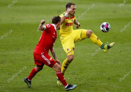 Cologne's Rafael Czichos (R) in action against Union's Max Kruse (L) during the German Bundesliga soccer match between FC Union Berlin and FC Koeln in Berlin, Germany, 13 March 2021.