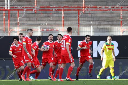 Max Kruse (C-L) of Union celebrates with teammates after scoring the 1-1 equalizer from the penalty spot during the German Bundesliga soccer match between FC Union Berlin and FC Koeln in Berlin, Germany, 13 March 2021.