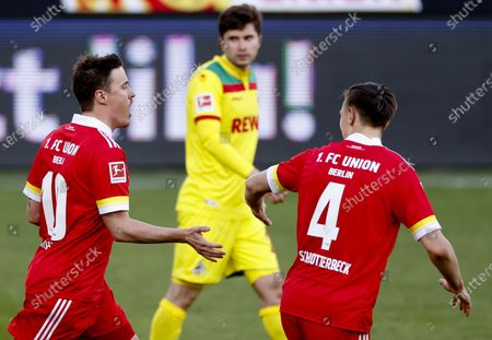Union's Max Kruse (L) celebrates with teammate Nico Schlotterbeck (R) after scoring the 1-1 equalizer from the penalty spot during the German Bundesliga soccer match between FC Union Berlin and FC Koeln in Berlin, Germany, 13 March 2021.