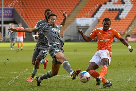 Fleetwood Town's defender James Hill (33) blocks Blackpool forward Sullay Kaikai (10) shot during the EFL Sky Bet League 1 match between Blackpool and Fleetwood Town at Bloomfield Road, Blackpool
