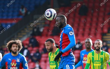 Crystal Palace's Cheikhou Kouyate heads the ball during the English Premier League soccer match between Crystal Palace and West Bromwich Albion at Selhurst Park stadium in London, England