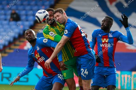 West Bromwich Albion's Kyle Bartley, center, Crystal Palace's Christian Benteke, left, and Gary Cahill challenge for the ball during the English Premier League soccer match between Crystal Palace and West Bromwich Albion at Selhurst Park stadium in London, England
