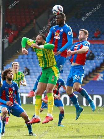 Crystal Palace's Christian Benteke, center, Gary Cahill, right, and West Bromwich Albion's Kyle Bartley, left, challenge for the ball during the English Premier League soccer match between Crystal Palace and West Bromwich Albion at Selhurst Park stadium in London, England