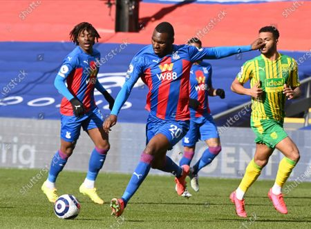 Crystal Palace's Christian Benteke, center, controls the ball during the English Premier League soccer match between Crystal Palace and West Bromwich Albion at Selhurst Park stadium in London, England