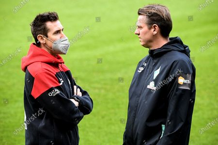 Stock Image of Former players Miroslav Klose (L) and Tim Borowski (R) talk prior to the German Bundesliga soccer match between Werder Bremen and Bayern Muenchen in Bremen, Germany, 13 March 2021.