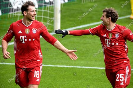 Stock Photo of Bayern's Leon Goretzka (L) celebrates with teammate Thomas Mueller (R) after scoring the 1-0 lead during the German Bundesliga soccer match between Werder Bremen and Bayern Muenchen in Bremen, Germany, 13 March 2021.