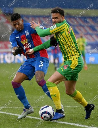 Patrick van Aanholt (L) of Crystal Palace in action against Hal Robson-Kanu (R) of West Bromwich during the English Premier League soccer match between Crystal Palace and West Bromwich Albion in London, Britain, 13 March 2021.