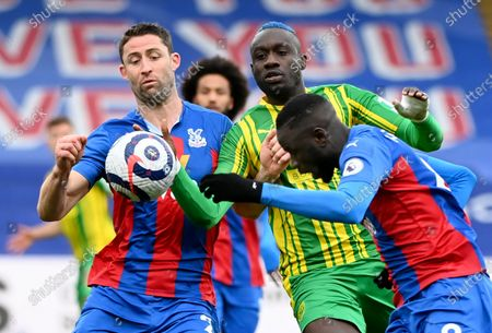 Gary Cahill (L) and Cheikhou Kouyate (R) of Crystal Palace in action against Mbaye Diagne (C) of West Bromwich during the English Premier League soccer match between Crystal Palace and West Bromwich Albion in London, Britain, 13 March 2021.