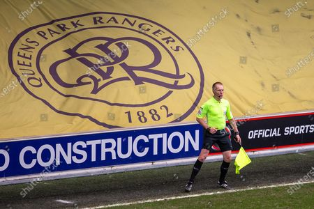 Stock Image of Assistant referee Michael George during the EFL Sky Bet Championship match between Queens Park Rangers and Huddersfield Town at the Kiyan Prince Foundation Stadium, London