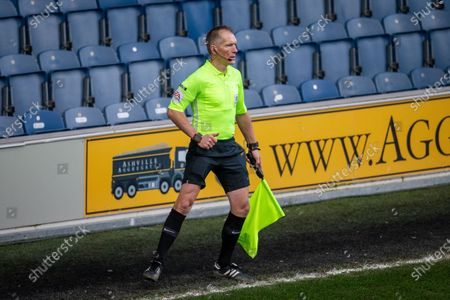 Assistant referee Michael George during the EFL Sky Bet Championship match between Queens Park Rangers and Huddersfield Town at the Kiyan Prince Foundation Stadium, London