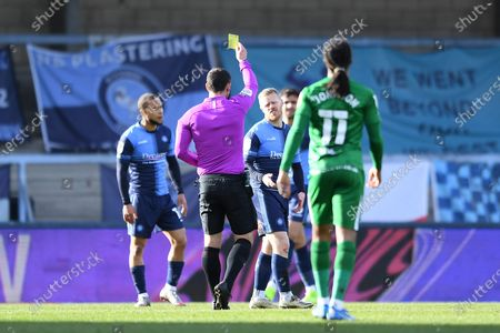 Wycombe Wanderers midfielder Daryl Horgan (17) is shown a yellow card, booked by Referee Tim Robinson during the EFL Sky Bet Championship match between Wycombe Wanderers and Preston North End at Adams Park, High Wycombe