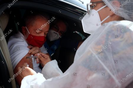 Stock Image of Former Brazilian president Luiz Inacio Lula da Silva is vaccinated against Covid-19 at a drive-thru in Sao Bernardo do Campo, Sao Paulo, Brazil, 13 March 2021. Former president Lula called on Brazilians to get vaccinated en masse to combat not only the Covid-19 pandemic but also the ignorance of deniers such as the current head of state Bolsonaro.