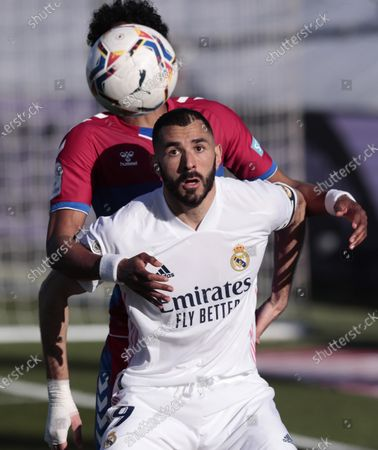 Real Madrid's Karim Benzema fights for the ball against Elche's Johan Mojica during the Spanish La Liga soccer match between Real Madrid and Elche at the Alfredo di Stefano stadium in Madrid, Spain