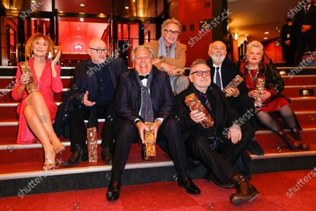 Stock Photo of The Splendid Troop : (L to R) Marie-Anne Chazel, Michel Blanc, Christian Clavier, Thierry Lhermitte, Bruno Moynot, GÃ'rard Jugnot and Josiane Balasko pose with the Honorary Cesar award at the 46th Cesar Film Awards 2021 ceremony at l'Olympia in Paris, on the 12th of march 2021, FRANCE