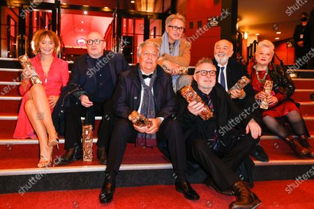 The Splendid Troop : (L to R) Marie-Anne Chazel, Michel Blanc, Christian Clavier, Thierry Lhermitte, Bruno Moynot, GÃ'rard Jugnot and Josiane Balasko pose with the Honorary Cesar award at the 46th Cesar Film Awards 2021 ceremony at l'Olympia in Paris, on the 12th of march 2021, FRANCE