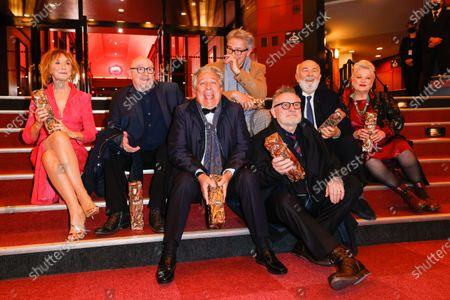 Stock Picture of The Splendid Troop : (L to R) Marie-Anne Chazel, Michel Blanc, Christian Clavier, Thierry Lhermitte, Bruno Moynot, GÃ'rard Jugnot and Josiane Balasko pose with the Honorary Cesar award at the 46th Cesar Film Awards 2021 ceremony at l'Olympia in Paris, on the 12th of march 2021, FRANCE