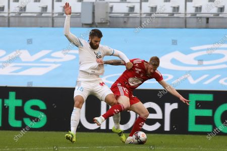 Stock Picture of Brest's Gaetan Charbonnier, right, is challenged by Marseille's Duje Caleta-Car during the French League One soccer match between Marseille and Brest at the Stade Veledrome stadium in Marseille, France