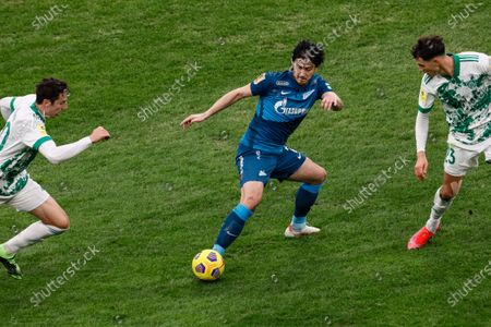 Sardar Azmoun (C) of Zenit Saint Petersburg in action against Zoran Nizic (L) and Anton Shvets of Akhmat during the Russian Premier League match between FC Zenit Saint Petersburg and FC Akhmat Grozny on March 13, 2021 at Gazprom Arena in Saint Petersburg, Russia.