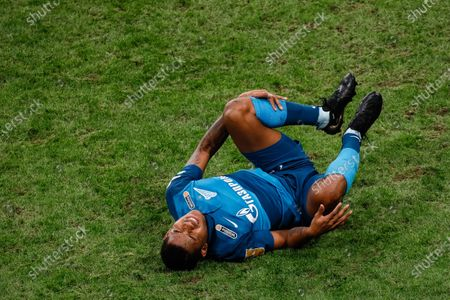 Wilmar Barrios of Zenit Saint Petersburg lies on the pitch in pain during the Russian Premier League match between FC Zenit Saint Petersburg and FC Akhmat Grozny on March 13, 2021 at Gazprom Arena in Saint Petersburg, Russia.
