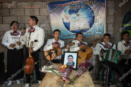 Stock Image of A Christian mariachi sings at the wake of Elfego Roliberto Miranda, one of the 16 Guatemalan migrants who died in Tamaulipas, Mexico, in Comitancillo, Guatemala 13 March 2021. The remains of the slain 16 undocumented Guatemalan migrants killed in northern Mexico in January 2021 were repatriated on 12 March.