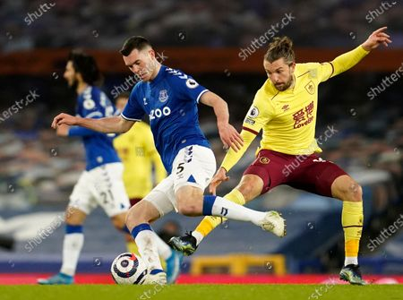 Everton's Michael Keane, left, duels for the ball with Burnley's Jay Rodriguez during the English Premier League soccer match between Everton and Burnley at Goodison Park in Liverpool, England