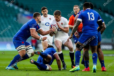 Stock Picture of Owen Farrell of England is tackled by Paul Willemse of France