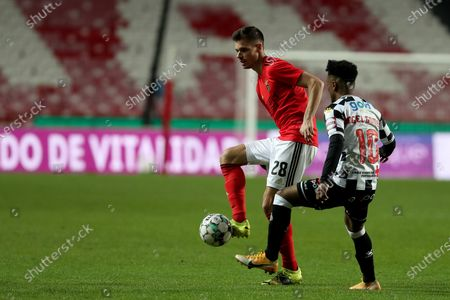 Julian Weigl of SL Benfica (L) vies with Angel Gomes of Boavista FC during the Portuguese League football match between SL Benfica and Boavista FC at the Luz stadium in Lisbon, Portugal on March 13, 2021.