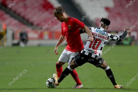 Luca Waldschmidt of SL Benfica (L) vies with Angel Gomes of Boavista FC during the Portuguese League football match between SL Benfica and Boavista FC at the Luz stadium in Lisbon, Portugal on March 13, 2021.