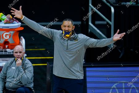 Michigan head coach Juwan Howard questions a call as his team played against Ohio State in the second half of an NCAA college basketball game at the Big Ten Conference tournament in Indianapolis