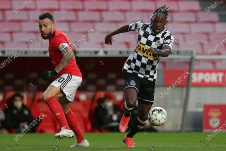 Benfica's Nicolas Otamendi (L) fights for the ball with Boavista's Alberth Elis (R) during the Portuguese First League soccer match between Benfica and Boavista held at Luz stadium in Lisbon, Portugal, 13 March 2021.