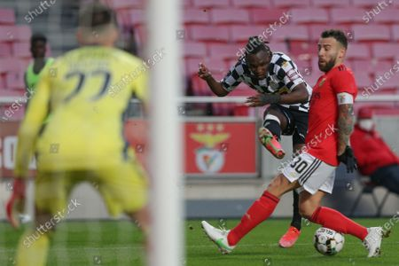 Benfica's Nicolas Otamendi (R) fights for the ball with Boavista's Alberth Elis (L) during the Portuguese First League soccer match between Benfica and Boavista held at Luz stadium in Lisbon, Portugal, 13 March 2021.