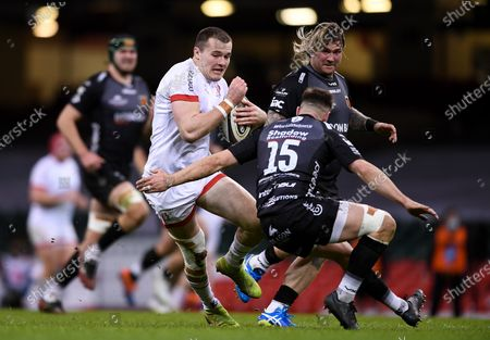 Dragons vs Ulster. Ulster's Jacob Stockdale comes up against Josh Lewis of Dragons