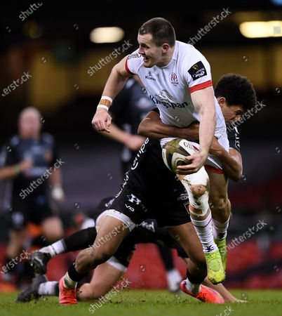 Dragons vs Ulster. Ulster's Jacob Stockdale is tackled by Josh Lewis of Dragons